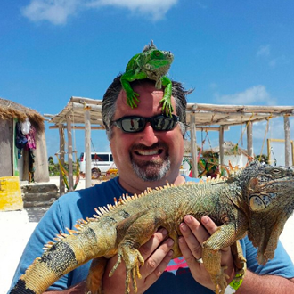 Dr. Scott Belshaw with iguanas in Cozumel