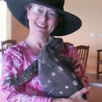 Rebecca Cagle with a large lizard