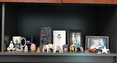 Dr. Cisneros' office bookshelf with mementos and gifts from students.