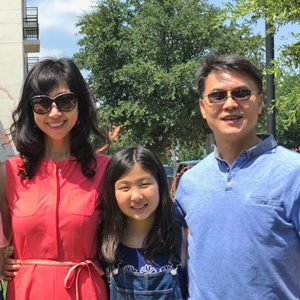 Dr. Dan Kim, UNT, with two members of his family