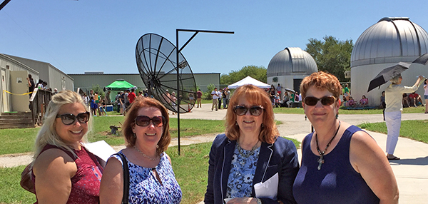 Photo of Clarissa Hutkowski, Maureen Saringer, Karen Snyder and Elizabeth Hinkle-Turner at the UNT Planetarium for the Aug. 21, 2017 solar eclipse.