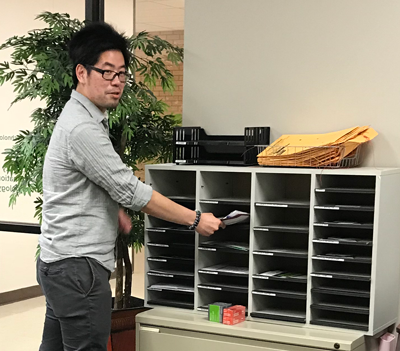 Yonathan Khoe picking up mail.