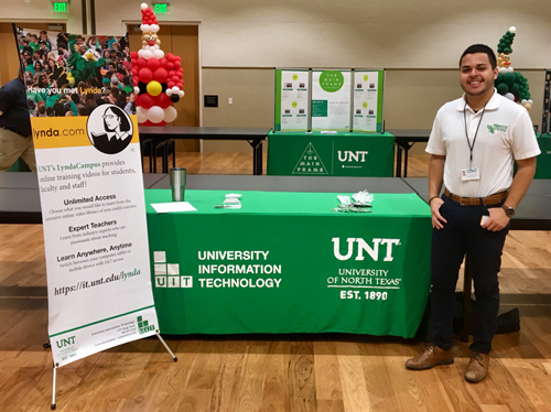 Benjamin Regalado pictured with the UIT table at the UNT Resource Fair for new students, Dec. 8, 2017.